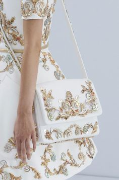 Chanel Haute Couture Fall 2014-15. Love the white purse. Nice gold details.