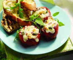 LOOKING FOR THE PERFECT SIDE? TRY THESE TOMATOES STUFFED WITH VEGETABLES AND TOPPED WITH CHEESE -- ALL GRILLED TO BUBBLY PERFECTION.