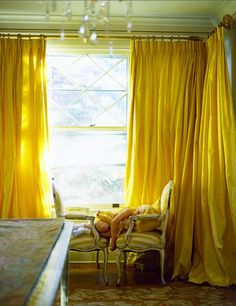 Bright bold yellow drapes.  Great for a bedroom, instant cheerful wakeup.