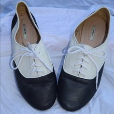 Brand new black and white lace up flats Want to look spiffy? Try these adorable vintage styled shoes that can bring together any outfit! Shoes