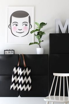 Ikea 'Trones' shoe storage in black and white entryway