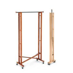 Image from http://www.cnbhomes.com/wp-content/uploads/2014/11/extraordinary-garment-rack-aris-2777-p3F5v.jpg.