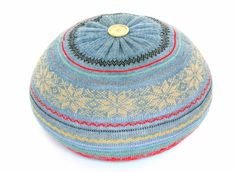 Upcycled sweater pouf by the Remakerie. Each pouf is lovingly created from a salvaged or repurposed sweater.