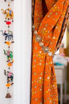 Nicole's Boho Entryway: Four Ways -- an old belt to tie back textiles/curtains