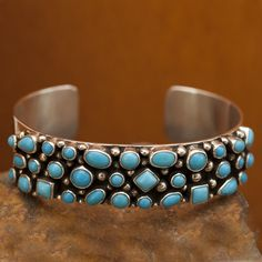 """This beautifully designed Sterling Silver Cuff Bracelet features Sleeping Beauty Turquoise, Is is handcrafted by Navajo Artists. Color may vary by computer monitor. Cuff Size: 5 3/4"""" Small Cuff Width:"""