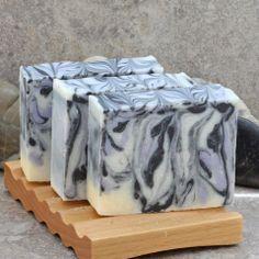 Blackberry Sage Cold Process Swirled Bar Soap – Alaiyna B. Bath and Body.  Swirls of black and purple in a pale yellow base.