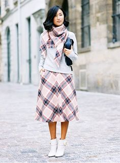 Femininity brought out by a soft gray sweater with a sweet printed skirt and ladylike boots. // #StreetStyle