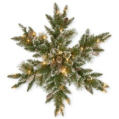 National Tree Company Green Glittery Bristle Pine Snowflake With White... ($60) ❤ liked on Polyvore featuring home, home decor, holiday decorations, christmas, green, white home accessories, pine cone home decor, outdoor holiday decor, outdoor home decor and holiday window decorations
