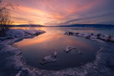 Cold as Ice II - Sunrise, Tyrifjorden, Norway. A few days of good old fashioned cold had produced some ice here and there. Nisi cpl, Sirui tripod and Lowepro Whistler.