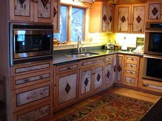 I like these cabinets because they are out of the ordinary...I'm not sure I'd like this exact design for my kitchen...