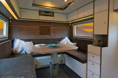 The table can be folded down to create an additional sleeping area for guests, and the veh...