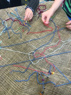 Sewing with wool on hessian and matchstick needles