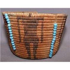 late 19th century Pima Indian basket with blue padre beads. Native American