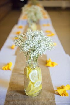 Cute and simple table setting with lemons and white flowers