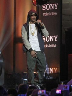 2013: Clifford Joseph Harris aka 'T.I. The Rapper'  honors the classic gangsta look in a live outdoor performance for Jimmy Kimmel's show in LA.