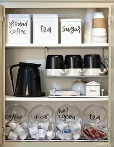 Coffee Cabinet with Printable Labels Use our hand lettered free printable pantry labels to create an organized coffee cabinet and pantry.Use our hand lettered free printable pantry labels to create an organized coffee cabinet and pantry. Kitchen Ikea, Kitchen Corner, Kitchen Pantry, New Kitchen, Kitchen Storage, Kitchen Cabinets, Pantry Storage, Kitchen Decor, Kitchen Sink