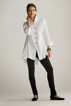white shirt over black leggings/jeans - it could have high-hip on-seam pockets (but I'll bet it doesn't)  PITY! ~mgh