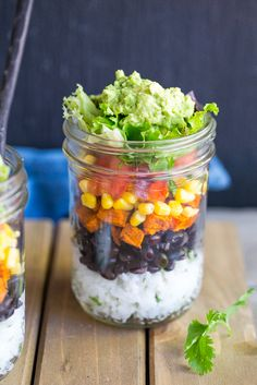 These Vegetarian Mason Jar Burrito Bowls can be made ahead of time and eaten for lunches or dinner!  Easy to assemble and lots of great flavors!  Vegan and gluten free.