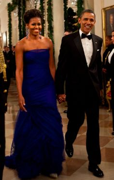 Michelle and Barack Obama. Love them. Michelle is wearing Vera Wang blue dress, super cute!