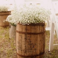 Whiskey barrels and fill them with bunches of Baby's Breath so that the barrels appear to be overflowing with them.