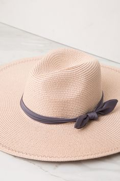 ed2ff79a645 Pink Bow Tie Band Floppy Straw Hat A floppy woven straw hat with a colored  band