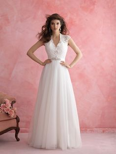 Allure Romance 2810 - Keep it sweet in our A-line gown — complete with lacy cap sleeves and a delightful keyhole back.