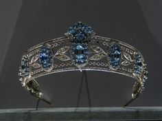 The aquamarine belle epoque tiara of Christian, Lady Hesketh, 1910. Featuring seven oval plaques of aquamarines, with hexagonal stone at the centre of each; linked by diamond laurel leaves and ropes of circular diamonds, enclosed in bands of diamonds top and bottom; and a plume of aquamarines over the central plaque. Sold by Sotheby's 17th May 2007, raising CHF120,000.