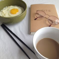 Journal, breakfast, coffee and chopsticks