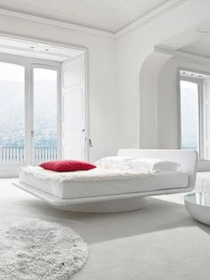 Swivel upholstered bed GIOTTO by @Bonaldo | #Design Gino Carollo #bedroom #white #interiors