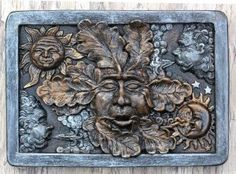 Anvindr green man wall plaque in a bronzed finish