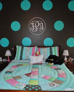 Cute Peace Sign comforter and love the wall paint.