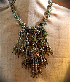 SALE Beaded Rainforest Necklace Beadweaving Semiprecious and Glass OOAK by Hannah Rosner  Originally $650 Beaded Rainforest Necklace. This item has been used as a sample for my pattern, also available in my Etsy store, at a few shows. As a result, it is on sale. It is still in perfect shape.  Cannot be lengthened or shortened.  This project was designed in two major steps. First, the spiral beadwork was worked around a core I strung on flexwire. Later, the fringe was added. 24Kt gold beads…
