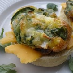 English Muffins topped with eggs and spinach. A simple Easter brunch idea.