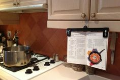 use a pants hanger as a cookbook holder | Useful tips, tricks and life hacks in the kitchen