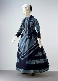 Cotton boating or seaside walking dress ca. 1872.  An ankle length hem indicates the dress was intended for walking outdoors.
