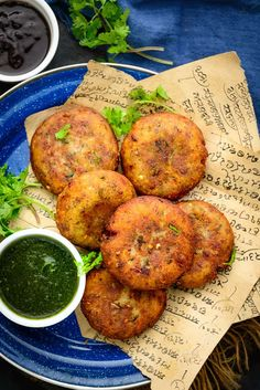 Aloo Tikki is a popular Indian street food which is basically crispy and spicy potato patty. It is one of the most popular chaat items and can be made easily at home too. Here is how to make Aloo Tikki recipe at home. Puri Recipes, Spicy Recipes, Indian Food Recipes, Snacks Recipes, Bhel Puri Recipe, Aloo Tikki Recipe, Green Chutney Recipe, Chutney Recipes, Korma