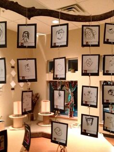 Reggio Emilia inspired classrooms and projects...hanging work vertically...using wire/bent paper clips?