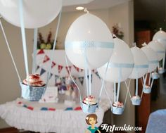Hot Air Balloon Cupcakes for a Travel Party What a cute idea, could be for new baby, or not just boys, for little girls too.
