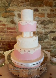 Beautiful white and pink separated iced cake