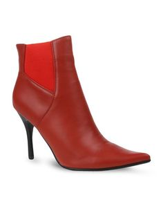 Put your best foot forward in the Streep Ankle Boots by Plum. This sleek design features a pointed nose and a faux leather upper. Deep red in colour, It showcases an elasticated insert for an adaptable fit, while a 9cm stiletto heel gives it height. Ideal for a night on the town, pair these sexy boots with a cheeky bandage dress and a high pony tail for an edgy and confident look.