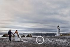 Walk by the Pencarrow lighthouse. Wedding photography in Wellington, NZ. By PaulMichaels http://www.paulmichaels.co.nz/