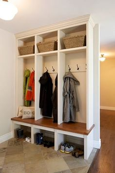 Individual cubbies for you kids shoes, bags and coats! Great idea!