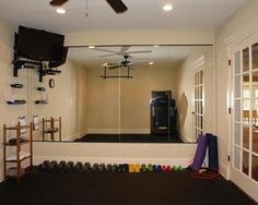 This is perfect; a treadmill and floor space to do weights and videos with pivoting TV...this is all I need!