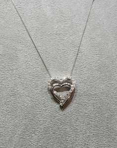 FREE Sterling Silver and Diamond heart necklace with purchase of $399.00 or more while supplies last!!
