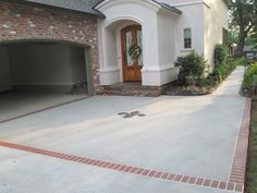 Concrete overlay with brick border and fleur de lis