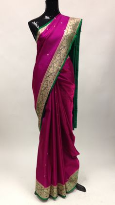 Beautiful pink green and gold banarasi silk saree with attached blouse piece. The sarees are among the finest sarees in India and are known for their gold and silver brocade or zari, fine silk and opu
