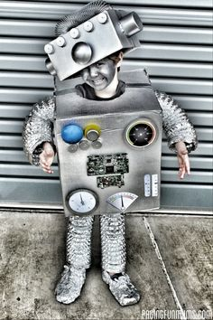 DIY Robot Costume - My son was 'nuts' for a Robot Party, so I 'bolt'-ed into action and got cracking on a costume for him to wear on the invitation and at the party. The best part about this costumes is that it is reasonably inexpensive to make – using mostly recycled parts!