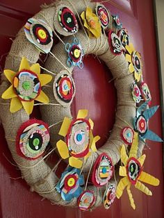 A burlap wreath with flowers made from old soda cans and water bottles
