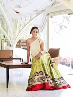 Sabyasachi - Bandana Tewari - lime green skirt with red, black, and gold accents; beige top
