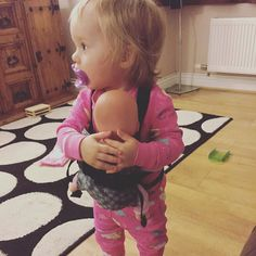 It's the witching hour for our dolly #babywearing #dollywearing #startthemyoung #closeenoughtokiss #toddlerwearing #roleplay #babywearingmama #beco #babyssc #16monthsold